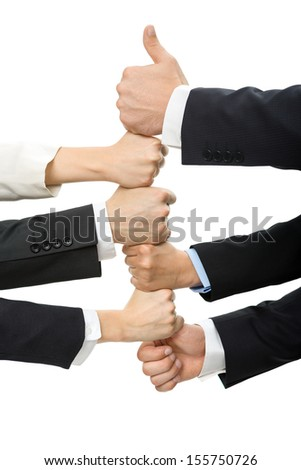 Close up of thumbing up hands, isolated on white. Concept of teamwork and cooperation - stock photo