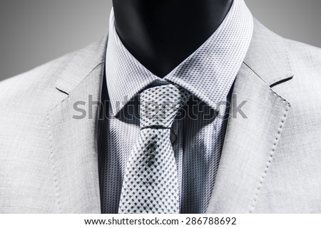 Close up of tie over elegant white suit. Black White - stock photo