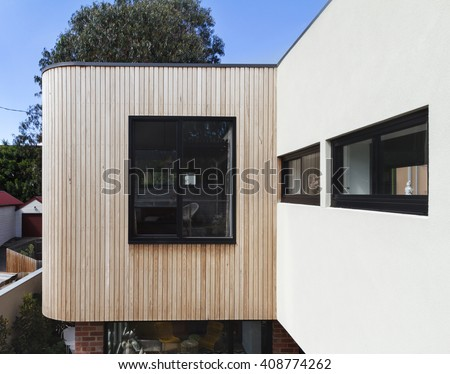 Close up of timber cladding slats on exterior renovation in Australia - stock photo