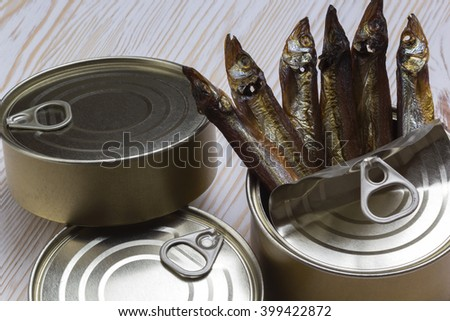 Close-up of Tinned capelin fish on wooden background