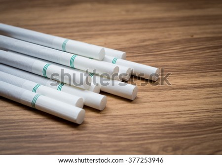 Close-up of Tobacco Cigarettes on wood background, unhealthy, selective focus - stock photo