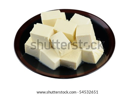 Close up of tofu on plate isolated on white - stock photo