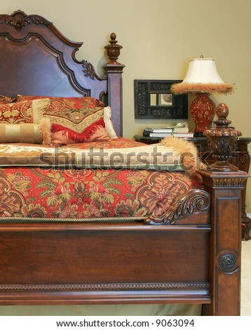 close up of traditional bed with linens - stock photo