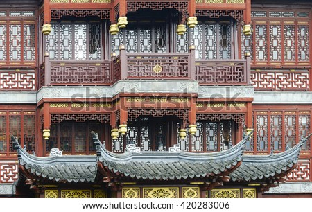 Close up of Traditional Chinese Style Wooden Architecture. Patterns of Chinese Traditional Wooden Windows. - stock photo