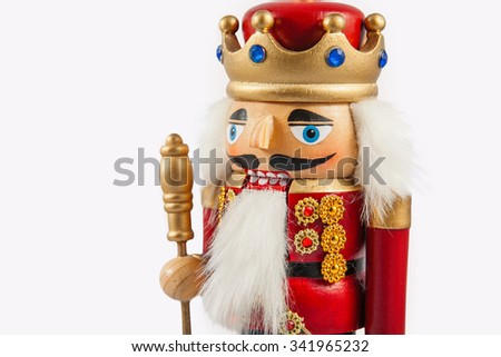 Close up of traditional figurine christmas nutcracker wearing an old military style uniform. Christmas background
