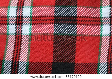 Close-up of traditional scottish checked material. stripes textile - stock photo