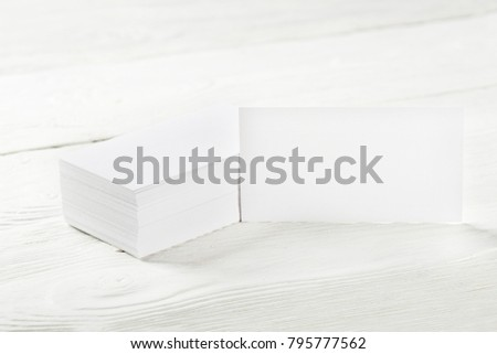 Close Up of two blank horizontal business cards at wooden background