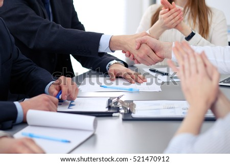 Close up of  two business man shaking hands to each other finishing up the meeting