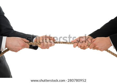 Close-up Of Two Businessman Pulling Rope Over White Background - stock photo