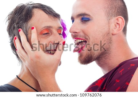 Close up of two funny transvestites flirting, isolated on white background.