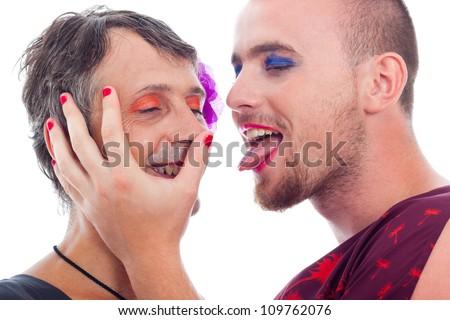 Close up of two funny transvestites flirting, isolated on white background. - stock photo