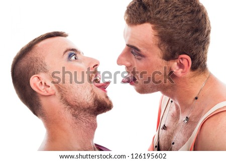 Close up of two funny transvestites sticking out tongue, isolated on white background. - stock photo