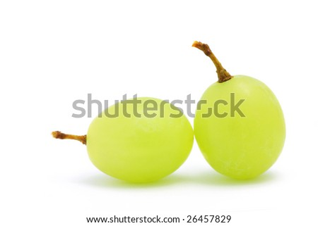 Close up of two green grapes isolated over white background. - stock photo