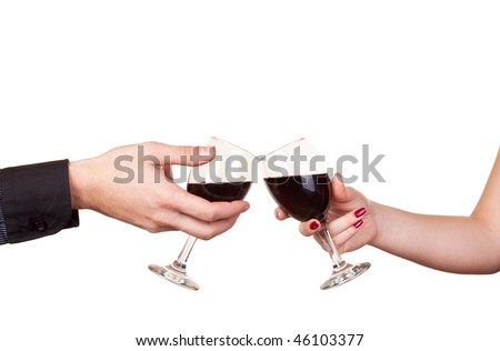 close up of two hands holding glasses of wine