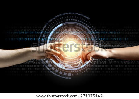 Close up of two hands reaching each other with fingers - stock photo