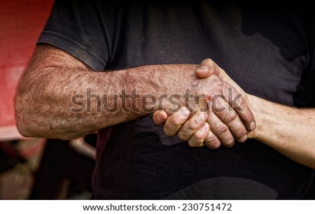 Close up of two male worker's hands making deal - stock photo