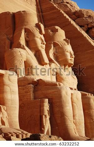 Close up of two Rameses II statues at Abu Simbel. - stock photo