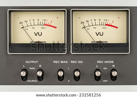 close up of two retro vu meter and switches - stock photo