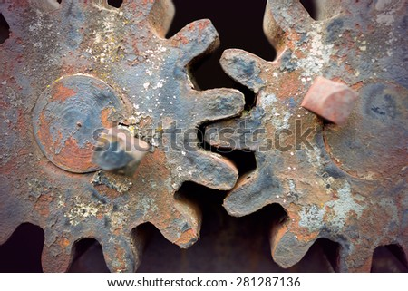 Close up of two rusty vintage cogwheels - stock photo