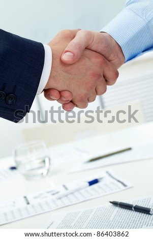 Close-up of two shaking hands