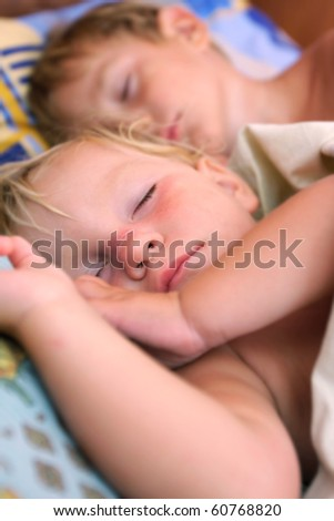 close up of two sleeping kids - stock photo
