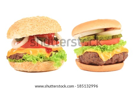 Close up of two tasty hamburgers. Isolated on a white background. - stock photo