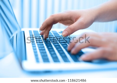 Close-up of typing female hands - stock photo