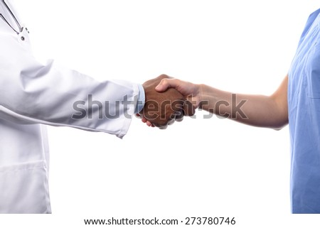 Close Up of Unidentifiable Medical Professionals Shaking Hands, One Wearing White Lab Coat and the Other Wearing Blue Scrubs, with White Background - stock photo