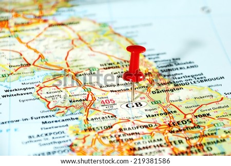 Close up of  United Kingdom  map with red pin - Travel concept - stock photo