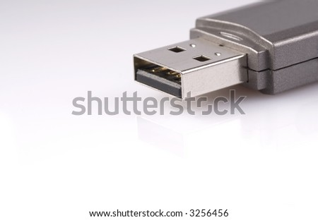 close-up of usb stick with reflection, isolated over white