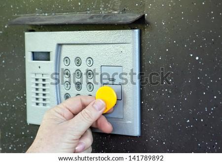 Close-up of uses intercom in steel door - stock photo