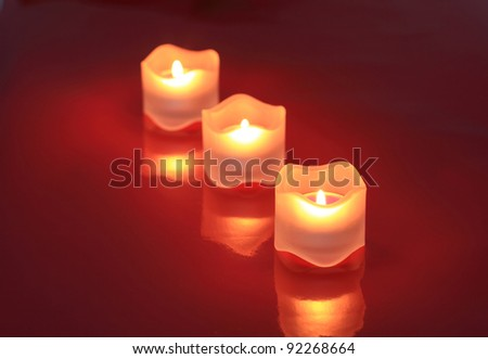 Close-up of valentine candles  isolated on red background - stock photo