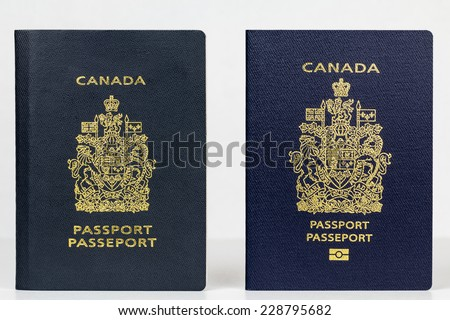Close up of valid Canadian passports, the older issued prior to July 2013 and the new ePassport  issued November 2014. The digital biometric passport differs in size, colour and has an electronic chip - stock photo