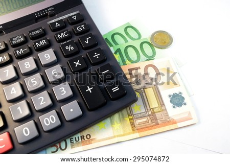 Close up of  Various currency notes and coins from different countries, calculator and gold - stock photo