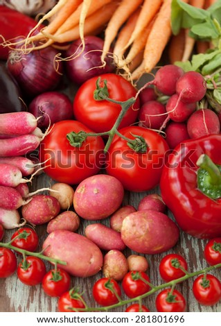 Close up of various red raw vegetables