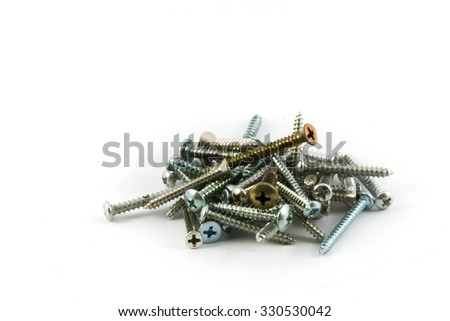 Close-up of various steel nuts - stock photo