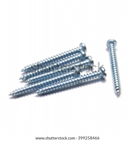 Close-up of various steel nuts and bolts on white background - stock photo