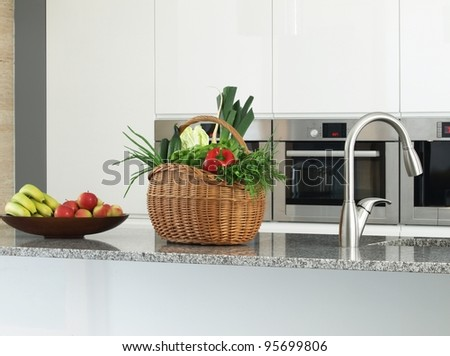 Close -up of vegetables and fruits in a modern kitchen interior - stock photo