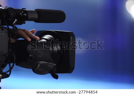 close up of video camera in TV studio - stock photo