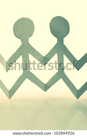 close up of vintage  paper people on white background - stock photo