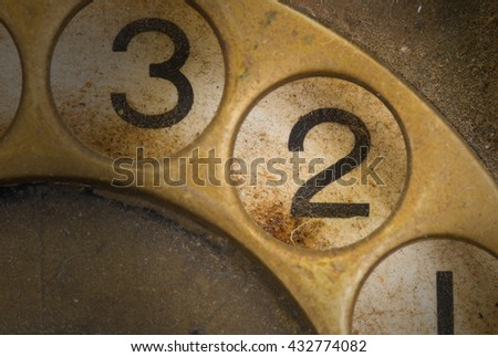 Close up of Vintage phone dial, dirty and scratched - 2 - stock photo