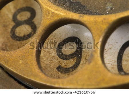 Close up of Vintage phone dial, dirty and scratched - 9, perspective - stock photo
