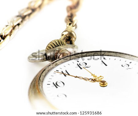 close up of vintage pocket watch on white - stock photo