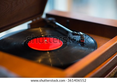 close up of vintage record player with vinyl disc - stock photo