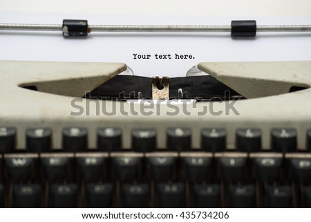 Close up of vintage typewriter with blank paper for input your text or your inscription.
