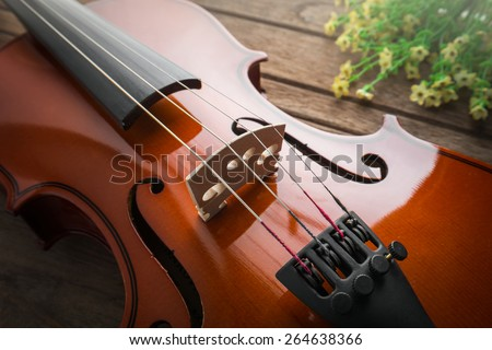 Close up of violin on wooden table  - stock photo
