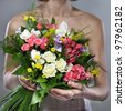 Close-up of vivid wedding bouquet at bride's hands - stock photo