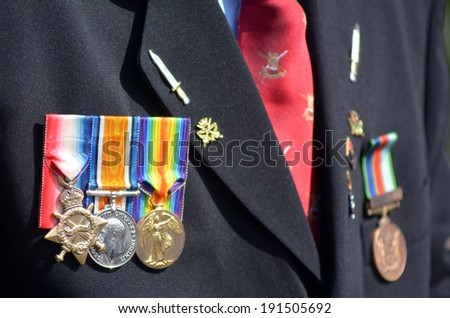 Close up of war medals on New Zealander soldier during a National War Memorial Anzac Day services in New Zealand. - stock photo