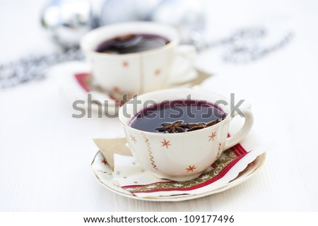 Close-up of warm mulled wine with star aniseed for Christmas - stock photo