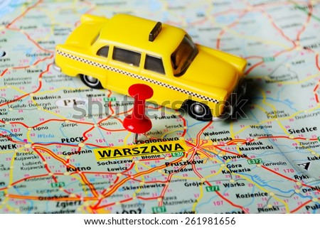 Close up of   Warsaw  , Poland  map with red pin and taxi toy - stock photo